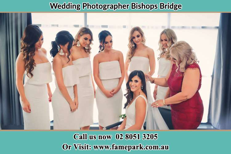 Photo of the Bride assisting by her maid of honor together with the bridesmaids Bishops Bridge NSW 2326
