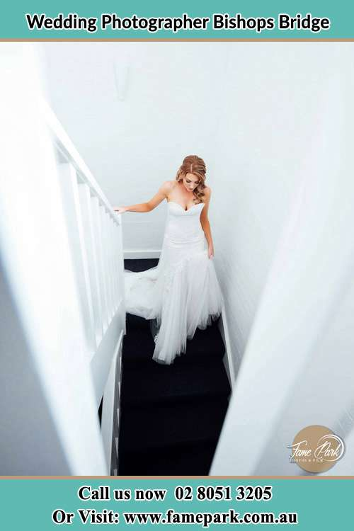 Photo of the Bride going down the stair Bishops Bridge NSW 2326