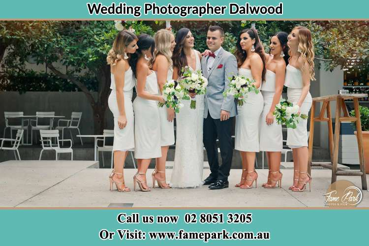 Photo of the Bride and the Groom together with the bridesmaids striking a pose Dalwood NSW 2335