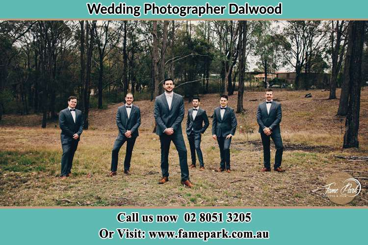 The Groom with his groomsmen pose in front of the camera Dalwood