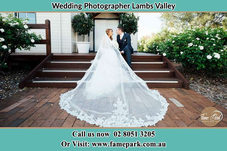 Elegant Photo of the Bride and the Groom sitting on the stair way Lambs Valley NSW 2335
