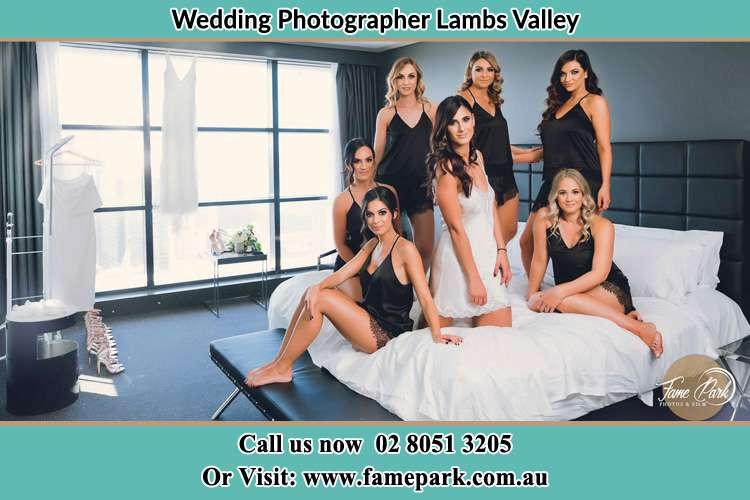 Photo of the Bride with her bridesmaids wearing sexy lingerie on the bed Lambs Valley NSW 2335