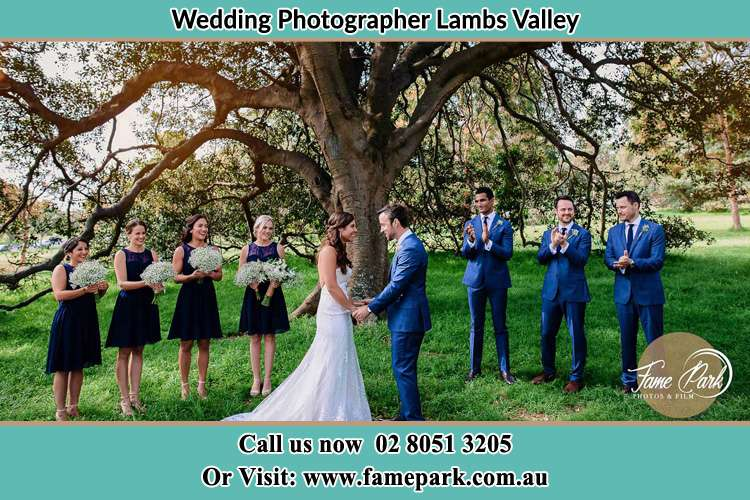 Photo of bride and groom with their entourage Lambs Valley