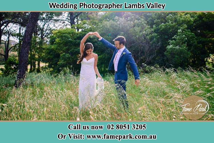 Photo of the Groom and the Bride dancing on the fields Lambs Valley