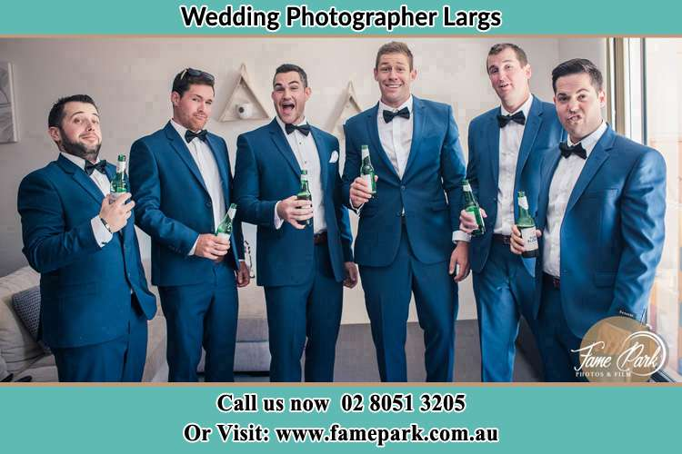 The groom and his groomsmen striking a wacky pose in front of the camera Largs NSW 2320