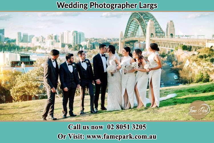 Photo of the Groom and the Bride with the entourage near the bridge Largs NSW 2320