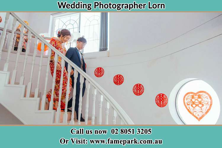 Photo of the Bride and the Groom going down the stairs Lorn NSW 2320