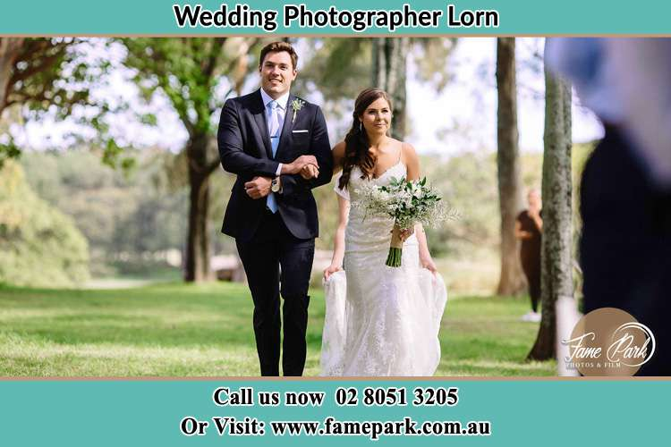 Photo of the Groom and the Bride walking the aisle Lorn NSW 2320
