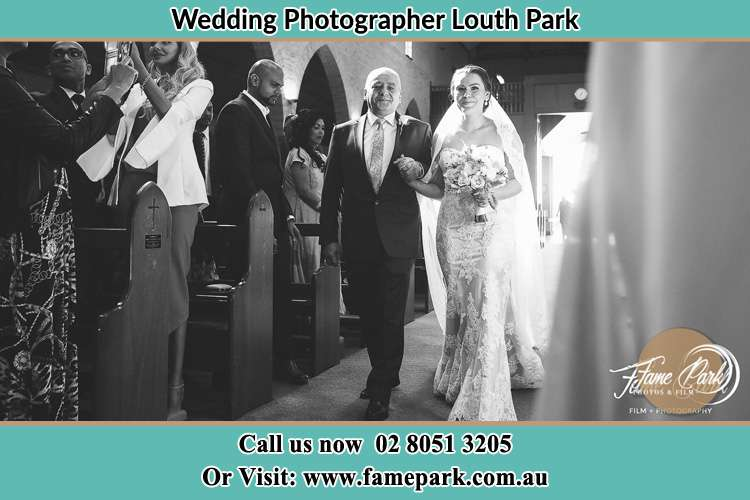 Photo of the Bride with her father walking the aisle Louth Park NSW 2320