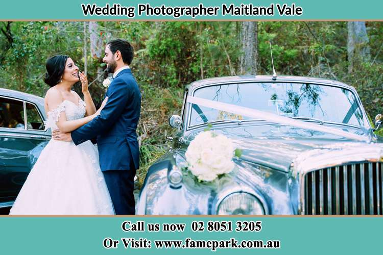 Photo of the Bride and Groom beside the bridal car Maitland Vale