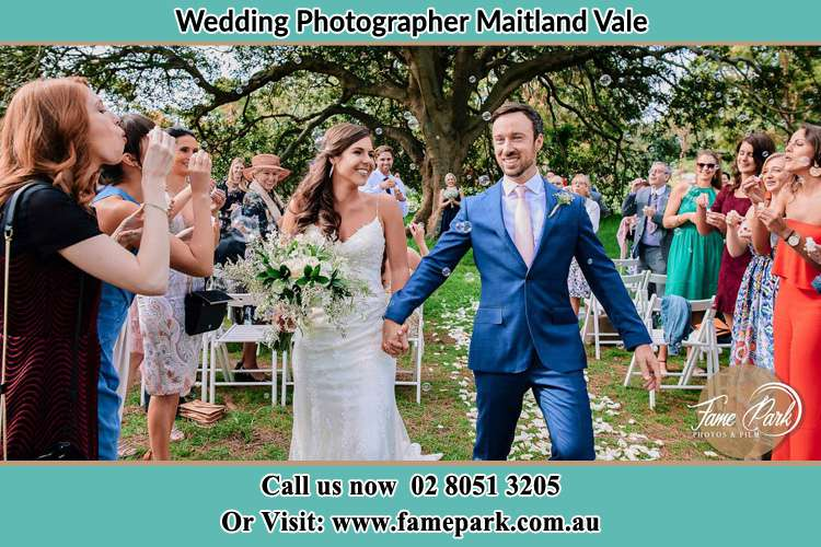 Photo of the Bride and the Groom showering bubbles by their visitors Maitland Vale NSW 2320