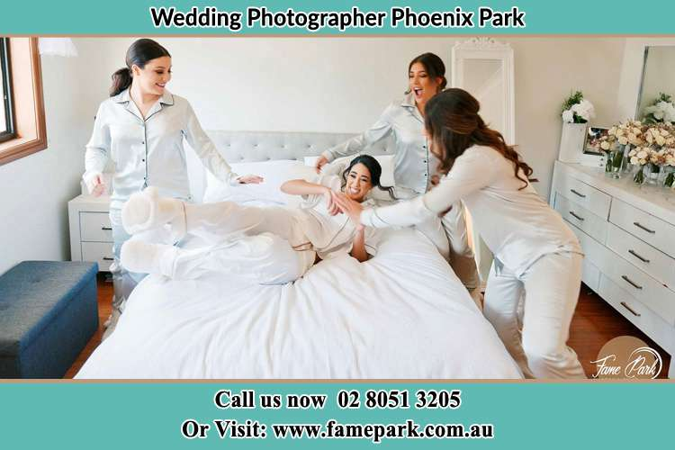 Photo of the Brides with her bridesmaids playing on bed Phoenix Park NSW 2321