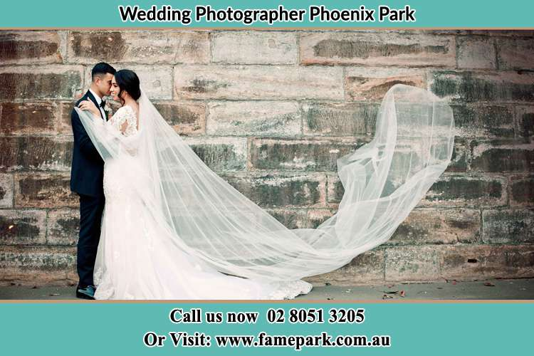 Romantic photo of the Groom and the Bride Phoenix Park NSW 2321