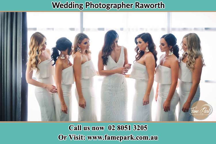 Photo of the Bride checking her ring as her bridesmaids looked on Raworth
