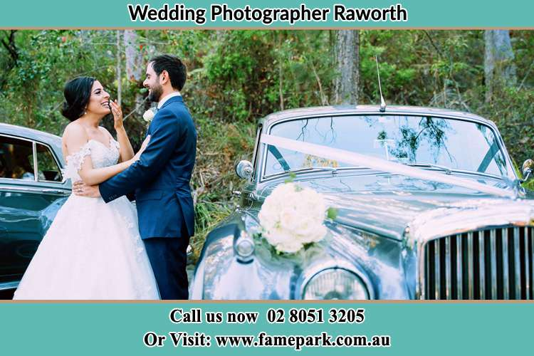Photo of the Bride and the Groom looking each other outside the car Raworth NSW 2321