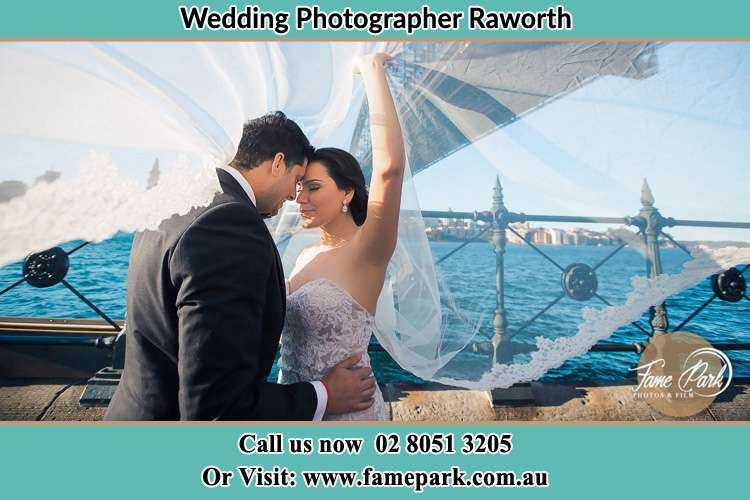 Photo of the Groom and the Bride in their romantic moment Raworth NSW 2321