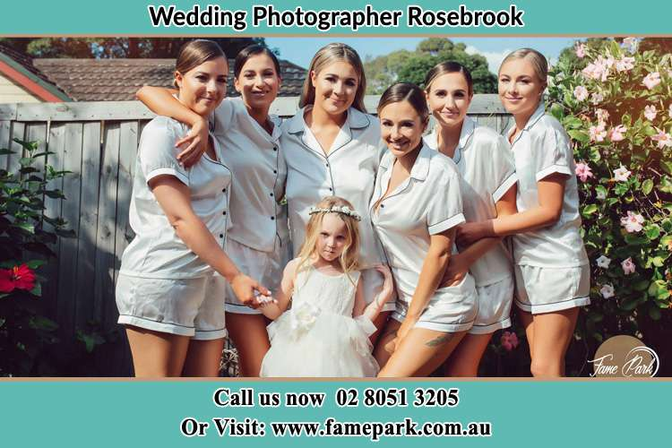 The Bride and her bridesmaids posed for the camera Rosebrook