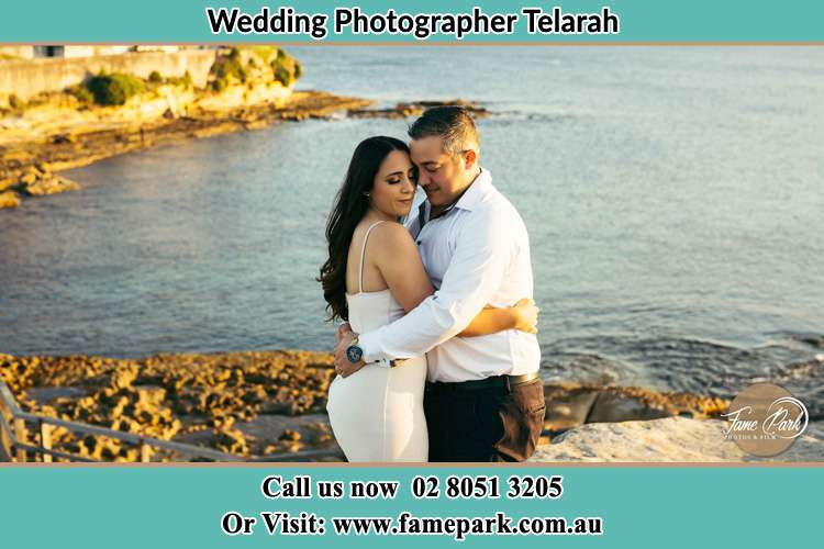 Photo of the Bride and Groom hugging Telarah