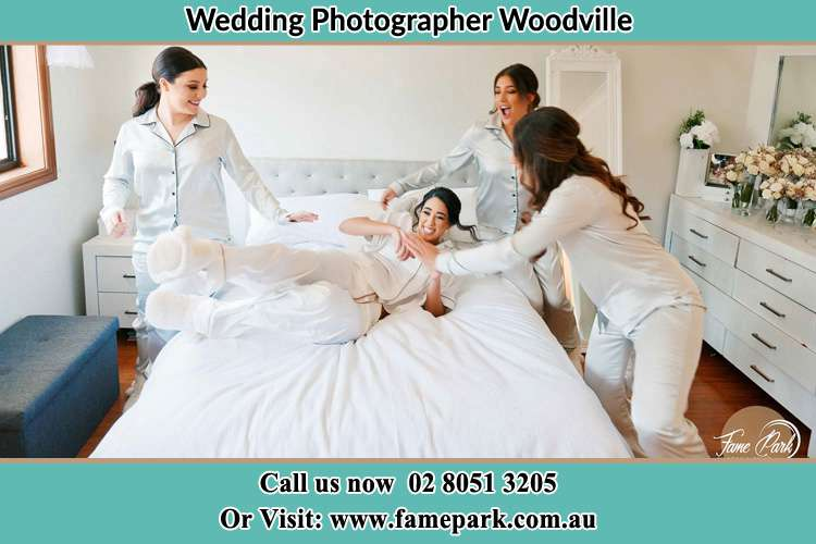 Photo of the Brides playing with the bridesmaid on the bed Woodville NSW 2321